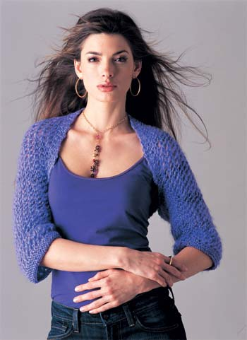 model wearing grape knit shrug