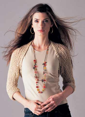 model wearing gold knit shrug
