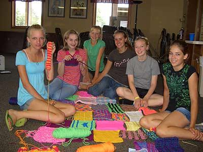 girls piecing afghan together