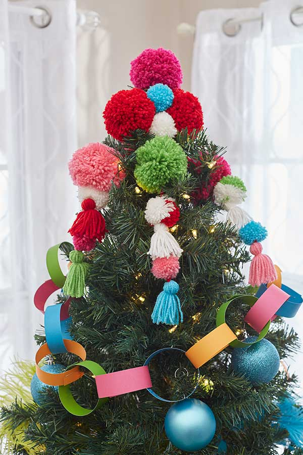 This bright and fun tree topper is made with a variety of pompom sizes and tassels - a great project for the kids to help with, too!